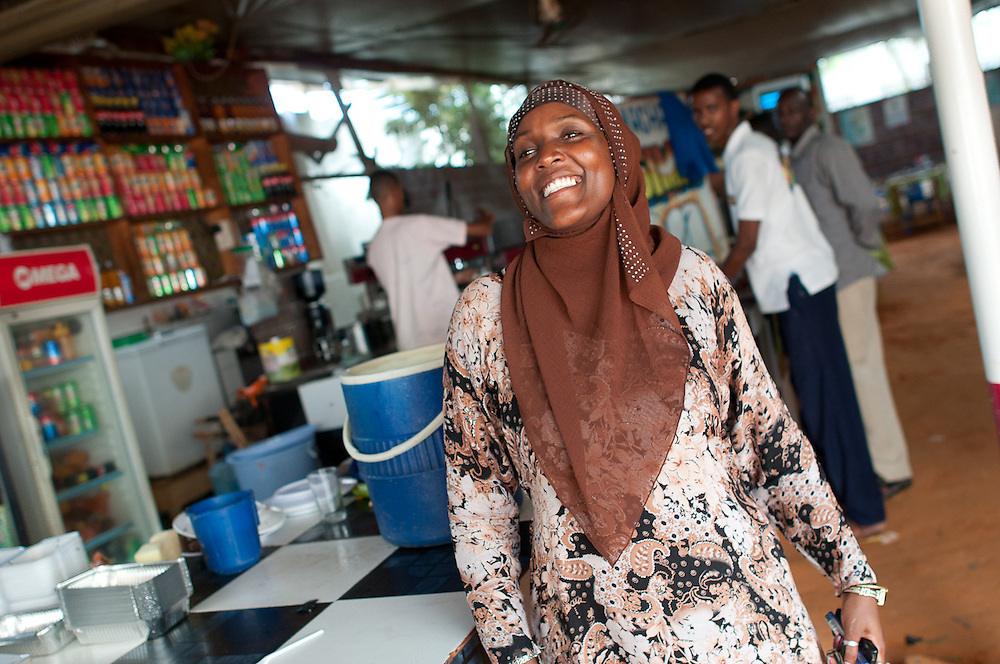 "Monica Nyambura, a Kenyan, is the manager of Village Cafe. ""I'm an economic refugee"" she claims, ""I love challenges, and Mogadishu is where the opportunity struck. If it was pluto, I would have gone."""