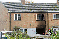 ©  London News Pictures. 15/10/2012. Harlow, UK. The burnt out rear of a property on Barn Mead, Harlow, Essex where three children and a woman have died and three others are in hospital following a house fire. Two boys aged 13 and six, a girl aged 11 and the woman were declared dead at the scene. A nine-year-old boy and a three-year-old girl have serious burns and a man has minor burns. Photo credit : Ben Cawthra/LNP