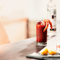 Lifestyle shot of bloody Mary with Kettle one vodka in the background shot as an advertisement in Los Angeles by Timothy Hogan