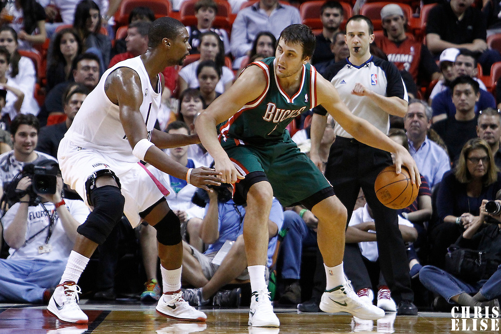 22 January 2012: Miami Heat power forward Chris Bosh (1) defends on Milwaukee Bucks center Andrew Bogut (6) during the Milwaukee Bucks 91-82 victory over the Miami Heat at the AmericanAirlines Arena, Miami, Florida, USA.