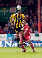 Photo: Leigh Quinnell.<br /> Swindon Town v Boston United. Coca Cola League 2. 30/09/2006. Bostons Frncis Green rises above Swindons Jerel Ifil.