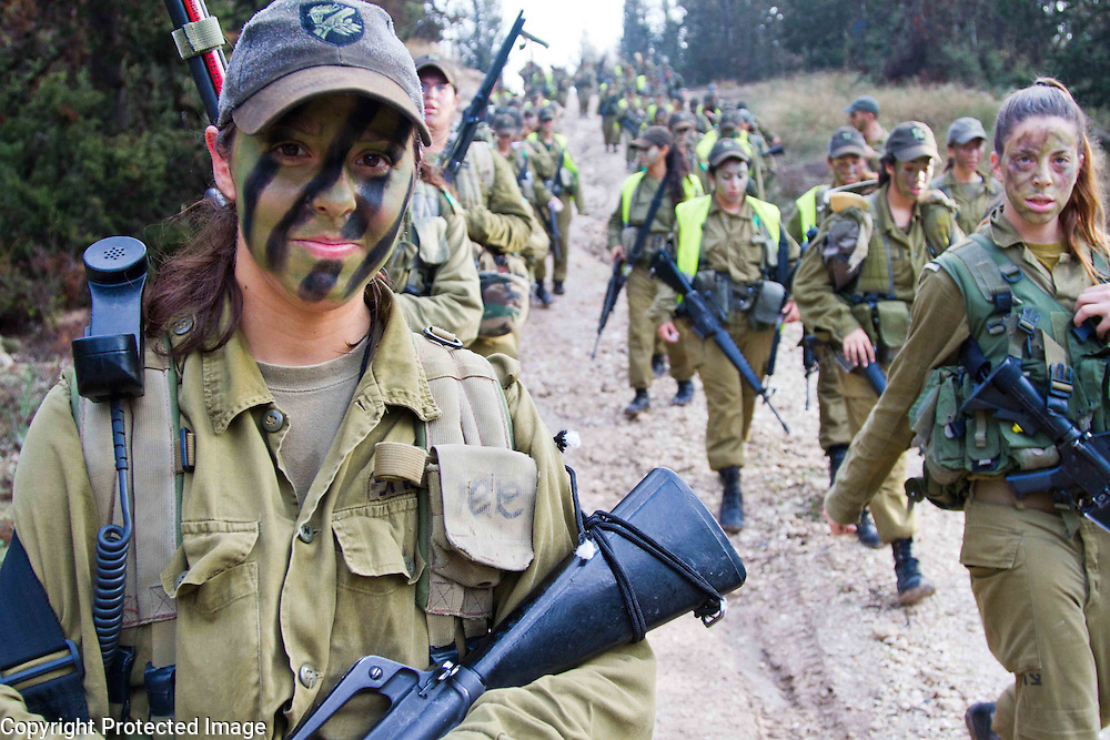 Israeli women in the army on a 12 km march. Photography by Debbie Zimelman