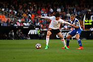 Valencia CF vs Deportivo La Coruña - La Liga MAtchday 29 - Estadio Mestalla, in action during g the game -- Carlos Soler from VAlencia CF (left) plays the ball against Berganitños (C) from Deportivo La Coruña (right)