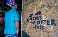A sign is seen at the entrance of a pub that is boarded up in preparation for hurricane Irma Friday, September 8, 2017 in Hollywood, FL, USA. Photo by /Paul Chiasson/CP/ABACAPRESS.COM