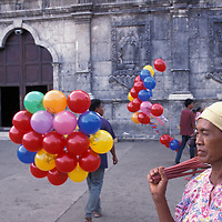 Philippines, Cebu Island, Woman sells incense outside Cebu's Basilica del Santo Niño.