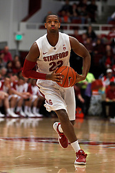 Dec 22, 2011; Stanford CA, USA;  Stanford Cardinal guard Jarrett Mann (22) passes the ball against the Butler Bulldogs during the first half at Maples Pavilion.  Butler defeated Stanford 71-66. Mandatory Credit: Jason O. Watson-US PRESSWIRE