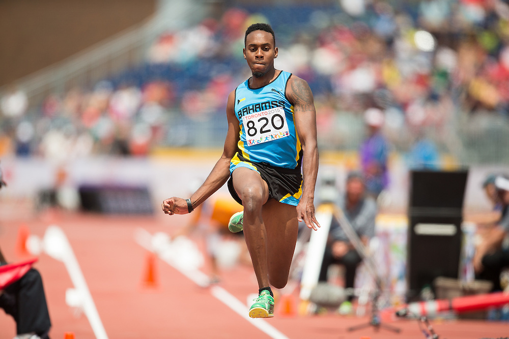 Leevan Sands of the Bahamas competes in the men's triple jump at CIBC Athletics Stadium at the 2015 Pan American Games in Toronto, Canada, July 24,  2015.  AFP PHOTO/GEOFF ROBINS