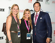 Jane Ettinger Booth, Alexa Georges, and guest on the red carpet during opening night of the 25th Anniversary New Orleans Film Festival; Opening night film is 'Black and White' directed by Mike Binder