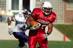 29 October 2005: Redbird Rafeal Rice takes flight. With a final score of 31 - 17, Western Illinois University Leathernecks collared the Illinois State University Redbirds knocking them from their 18th ranked perch at Hancock Field on Illinois State's campus in Normal IL