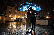 Lighting the couple from behind during heavy rain really helped to create a dramatic wedding portrait