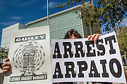 "19 JULY 2012 - PHOENIX, AZ:  An opponent of Maricopa County Sheriff Joe Arpaio pickets the front of the US Courthouse on the first day of a class action lawsuit, Melendres v. Arpaio in Phoenix Thursday. The suit, brought by the ACLU and MALDEF in federal court against Maricopa County Sheriff Joe Arpaio, alleges a wide spread pattern of racial profiling during Arpaio's ""crime suppression sweeps"" that targeted undocumented immigrants. U.S. District Judge Murray Snow granted the case class action status opening it up to all Latinos stopped by Maricopa County Sheriff's Office deputies during the crime sweeps. The case is being heard in Judge Snow's court.  PHOTO BY JACK KURTZ"