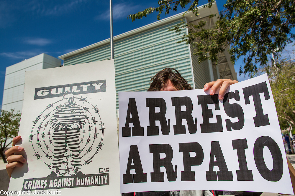"""19 JULY 2012 - PHOENIX, AZ:  An opponent of Maricopa County Sheriff Joe Arpaio pickets the front of the US Courthouse on the first day of a class action lawsuit, Melendres v. Arpaio in Phoenix Thursday. The suit, brought by the ACLU and MALDEF in federal court against Maricopa County Sheriff Joe Arpaio, alleges a wide spread pattern of racial profiling during Arpaio's """"crime suppression sweeps"""" that targeted undocumented immigrants. U.S. District Judge Murray Snow granted the case class action status opening it up to all Latinos stopped by Maricopa County Sheriff's Office deputies during the crime sweeps. The case is being heard in Judge Snow's court.  PHOTO BY JACK KURTZ"""