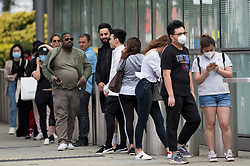 © Licensed to London News Pictures. 03/07/2020. London, UK. Members of the public form a long queue around Westfield Shopping Centre in Shepherd's Bush, West London for the opening of Harrods Outlet store. Photo credit: Ben Cawthra/LNP