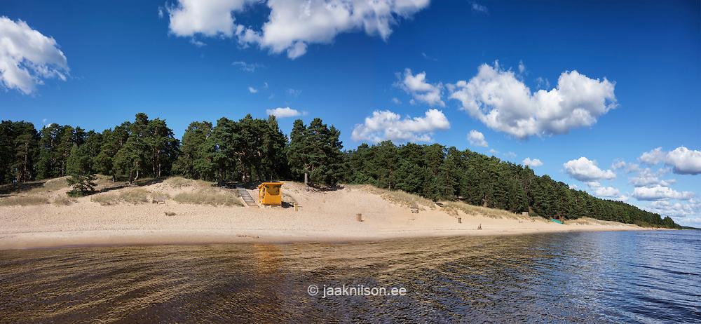 Lakeside or seaside beach kiosk. Hilly landscape coastline with sand dunes. Forest, water, sea. Lake Peipsi in Kauksi, Estonia.