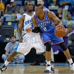 Oct 10, 2009; New Orleans, LA, USA; New Orleans Hornets guard Chris Paul (3) defends Oklahoma City Thunder guard Russell Westbrook (0) during a preseason game at the New Orleans Arena. The Hornets defeated the Thunder 88-79. Mandatory Credit: Derick E. Hingle-US PRESSWIRE