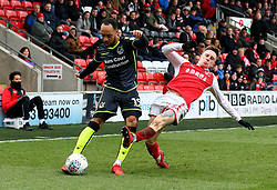 Byron Moore of Bristol Rovers is tackled by Ashley Hunter of Fleetwood Town - Mandatory by-line: Robbie Stephenson/JMP - 02/04/2018 - FOOTBALL - Highbury Stadium - Fleetwood, England - Fleetwood Town v Bristol Rovers - Sky Bet League One