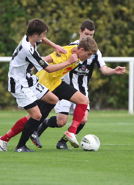 Waikato FC's Tyler Boyd, right, beats Hawkes Bay United's Tom Biss in the teams ASB Premiership Football match at Park Island, Napier, New Zealand, 11 March 2012, Photo: SNPA / John Cowpland