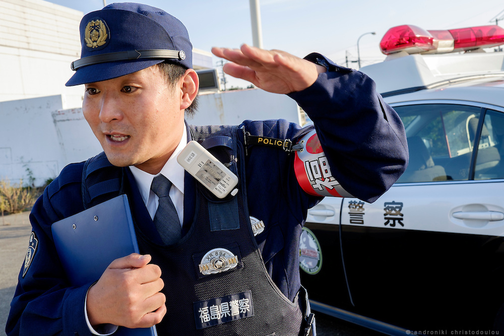 Local policeman who is wearing a docimeter to measure the radiation that he receives during his work.
