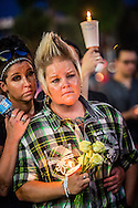 Kyra and Crystal Murphy (left) during the Equality Florida candle light vigil at Dr. Phillips Center, photo by Roberto Gonzalez Aftermath of the Pulse nightclub shooting in Orlando, Florida.