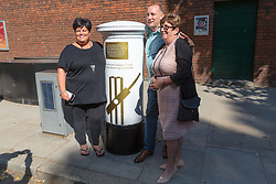 Passersby pose for a picture as Royal Mail unveils a white-painted postbox outside Lords Cricket Ground with a plaque and graphics that celebrate England's ICC Cricket World Cup Victory. London, July 16 2019.