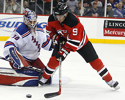 November 14, 2007; Newark, NJ, USA;  New York Rangers goalie Henrik Lundqvist (30) makes a save against New Jersey Devils left wing Zach Parise (9) during the second period at the Prudential Center in Newark, NJ.  The Rangers won the game 4-2.