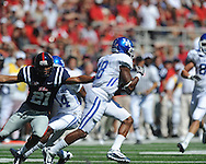 Ole Miss wide receiver Lionel Breaux (21) chases Kentucky's Randall Cobb (18) on a punt return at Vaught-Hemingway Stadium in Oxford, Miss. on Saturday, October 2, 2010. Ole Miss won 42-35 to improve to 3-2..