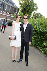 SOPHIE ELLIS-BEXTOR and RICHARD JONES at the Fashion Rules Exhibition Opening at Kensington Palace, London W8 on 4th July 2013.
