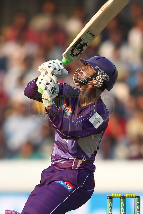 Shoaib Malik of the Hobart Hurricanes looks on as the ball goes for six during the first semi final match of the Oppo Champions League Twenty20 between the Kolkata Knight Riders and the Hobart Hurricanes held at the Rajiv Gandhi Cricket Stadium, Hyderabad, India on the 2nd October 2014<br /> <br /> Photo by:  Shaun Roy / Sportzpics/ CLT20<br /> <br /> <br /> Image use is subject to the terms and conditions as laid out by the BCCI/ CLT20.  The terms and conditions can be downloaded here:<br /> <br /> http://sportzpics.photoshelter.com/gallery/CLT20-Image-Terms-and-Conditions-2014/G0000IfNJn535VPU/C0000QhhKadWcjYs
