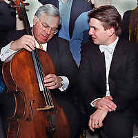 MAYOR THOMAS MENINO PLAYS THE CELLO DURING A BREAK IN A PHOTO SHOOT HE ALONG WITH KEITH LOCKHART, RICO PETROCELLI, ROBERT PARKER AND MANY OTHERS WERE INVOLVED WITH TODAY JAN12'00 AT THE SOUTH END PHOTO STUDIO OF PETER URBAN. PHOTO: MARK GARFINKEL