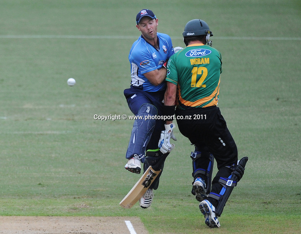 Central's Peter Ingram is run out off a direct hit by Martin Guptill and collides with Gareth Hopkins during the HRV Twenty20 Cricket match between the Auckland Aces and Central Stags at Colin Maiden Oval in Auckland, New Zealand on Thursday 12 January 2012. Photo: Andrew Cornaga/Photosport.co.nz