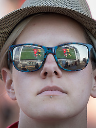 i© Licensed to London News Pictures. 07/07/2018. Brighton, UK.  England's 2-0 quarter-final win over Sweden at the Russian World Cup is reflected in the sun glasses of a football fan on the sea front in Brighton. Photo credit: Peter Macdiarmid/LNP