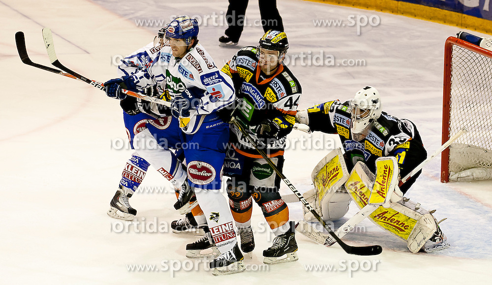 30.12.2011, Eisstadion Liebenau, Graz, AUT, EBEL, Moser Medical Graz 99ers vs EC Rekord Fenster VSV im Bild Roland Kaspitz (EC Rekord Fenster VSV, #8, Forward) und Olivier Latendresse (Moser Medical Graz 99ers, #44, Offender) sowie Frederic Cloutier (Moser Medical Graz 99ers, #33, Goalkeeper) // during the Erste Bank Icehockey League, Eisstadion Liebenau, Graz, Austria, 2011-12-30, EXPA Pictures © 2011, PhotoCredit: EXPA/ E. Scheriau