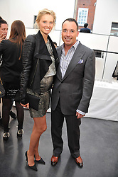 MALIN JEFFERIES and DAVID FURNISH at a private view of photographs by Herb Ritts held at Hamiltons Gallery, 13 Carlos Place, London on 21st June 2011.