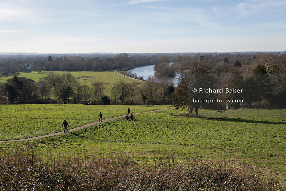 Walkers climb the hill from the river Thames floodplain and up Richmond Hill, on 3rd February 2019, in London, England.