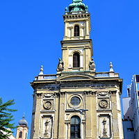 St Anne's Church in Budapest, Hungary<br /> The Friar Servants of Mary is a Catholic order established in Italy in 1233. While the Servite Friars were spreading across central Europe, one monastery was established in Budapest in 1686. Their Church of St Anne, located in Servite Square, was constructed in 1732. The bell tower of the Servite Church was added to the Baroque façade in 1871. Below the spire are the statues of St. Augustine and St. Philip.