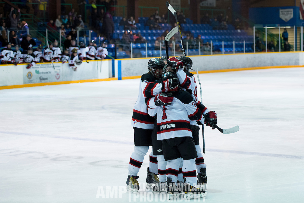 Mustang Captain Mike Arnold is congratulated by his teammates for scoring the first goal of the Midget A Mustang and Aldengrove game.
