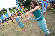 Two girls playing with Hula Hoops at the Workhouse Festival, Wales, 2006