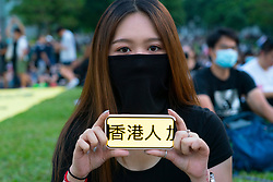 Central, Hong Kong. 29 September, 2019. Rally by thousands of pro-democracy supporters at Central Government offices at Tamar Park to mark the 5th anniversary of the start of the Umbrella Movement. Woman uses phone to show message of support for Hong Kong people. Iain Masterton/Alamy Live News.