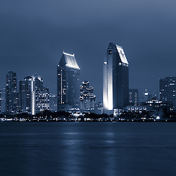 San Diego at night with downtown city building skyline along San Diego Bay.
