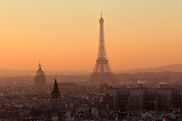 An early evening view out over the Eiffel Tower and Paris from the roof of Notre Dame Cathedral. Paris, France, Europe.