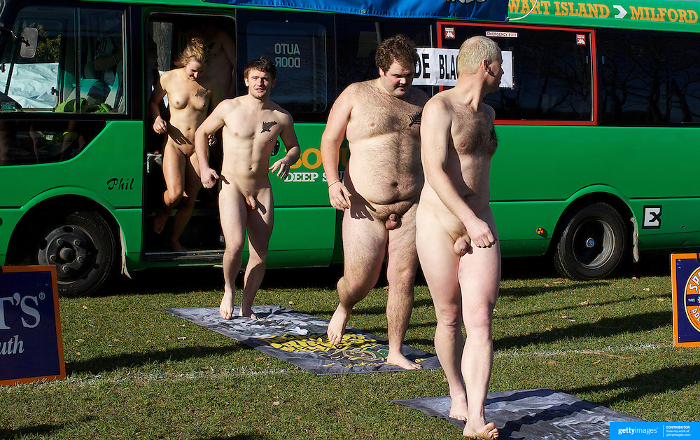 The' Nude Blacks' emerge from the team bus for the 'Nude Blacks' versus a Fijian invitation side played at Logan Park, Dunedin as an unofficial curtain raiser match before the New Zealand V Fiji test match in Dunedin, New Zealand...The 'Nude Blacks' won the match 20-10 with 21 year old female player Rachel Scott, a member of the Otago women's rugby team named player of the day. .Over 500 people turned up to watch the match which included a blind referee, Julie Woods and three clothed streakers who were ejected from the playing area..The 'Nude Blacks' traditionally play games before test matches in Dunedin and were using this match as a warm up for three nude games planned during the IRB Rugby World Cup in New Zealand with teams from Argentina, Italy, England and Ireland involved.  Matches will be played before World Cup games in Dunedin. New Zealand. 22nd July 2011. Photo Tim Clayton