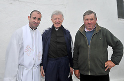 At the summit of Croagh Patrick  were newly ordained priest Fr Sean Flynn, Archbishop of Tuam Dr.Michael Neary and John Cummins pictured on the summit of Croagh Patrick yesterday.<br /> Pic Conor McKeown
