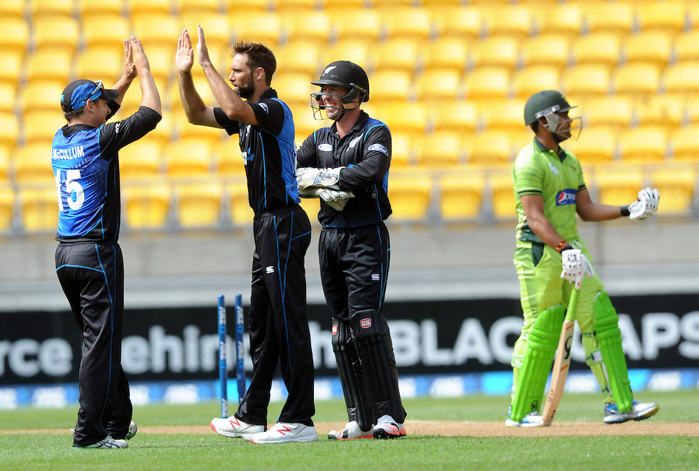 New Zealand's Grant Elliott, centre, after bowling Pakistan's Umar Akmal for 13 in the 1st One Day International cricket match at Westpac Stadium, New Zealand, Saturday, January 31, 2015. Credit:SNPA / Ross Setford