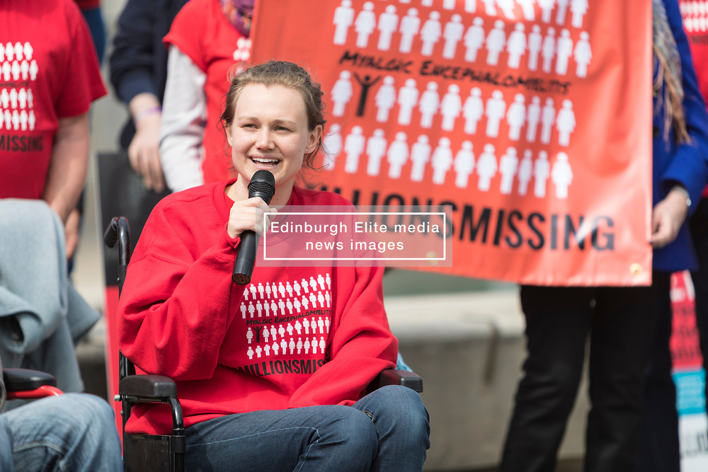 Missing Millions highlights the 21,000 people in Scotland who suffer from ME, also known as chronic fatigue system. Stuart Murdoch, lead singer of Belle and Sebastian, and author Ali Smith are supporting the campaign.<br /> <br /> Protesters stand in front of rows of empty shoes to represent people with ME missing from their lives. <br /> <br /> Pictured: Emma Shorter was in her first year at St Andrews University when she was hit by the illness and is leading the campaign outside the Scottish Parliament