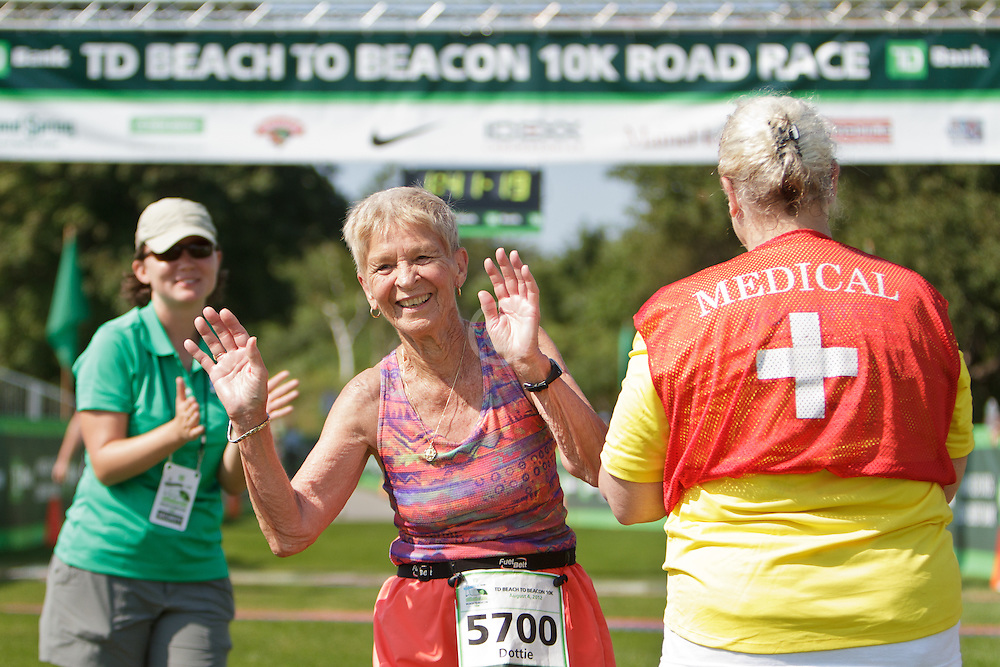 Beach to Beacon 10K Dottie Gray, 87, Shrewsbury, MA, crosses finish line, winner of John Kelley Award