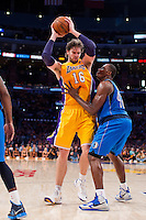 30 October 2012: Forward (16) Pau Gasol of the Los Angeles Lakers holds the ball while being defended by (42) Elton Brand of the Dallas Mavericks during the XX half of the Mavericks 99-91 victory over the Lakers at the STAPLES Center in Los Angeles, CA.
