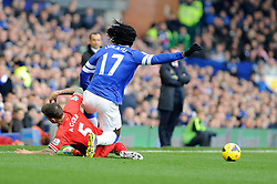 Liverpool's Daniel Agger tackles Everton's Romelu Lukaku - Photo mandatory by-line: Dougie Allward/JMP - Tel: Mobile: 07966 386802 23/11/2013 - SPORT - Football - Liverpool - Merseyside derby - Goodison Park - Everton v Liverpool - Barclays Premier League