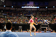 Urbandale's Rachel Gowey warms up on the floor as coach Liang Chow (left) look on Sunday, June 26, 2016, at the P&G Gymnastics Championships at Chaifetz Arena in St. Louis. The national championships help determine who will compete at the Olympic Trials next month.