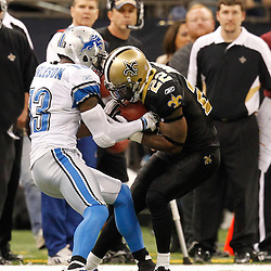 December 4, 2011; New Orleans, LA, USA; New Orleans Saints cornerback Tracy Porter (22) intercepts the ball from Detroit Lions wide receiver Nate Burleson (13) during the second half of a game at the Mercedes-Benz Superdome. The Saints defeated the Lions 31-17. Mandatory Credit: Derick E. Hingle-US PRESSWIRE