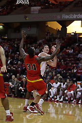 11 December 2010: Paris Carter falls away as Blake Mishler takes a shot during an NCAA basketball game between the Illinois - Chicago Flames (UIC) and the Illinois State Redbirds (ISU) at Redbird Arena in Normal Illinois.